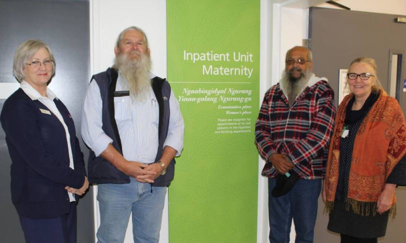 Team with inpatient maternity nursing sign